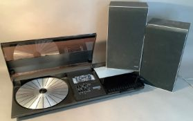 A Bang & Olufsen Beocenter 2200 with pair of Bang & Olufsen Beovox X25 speakers