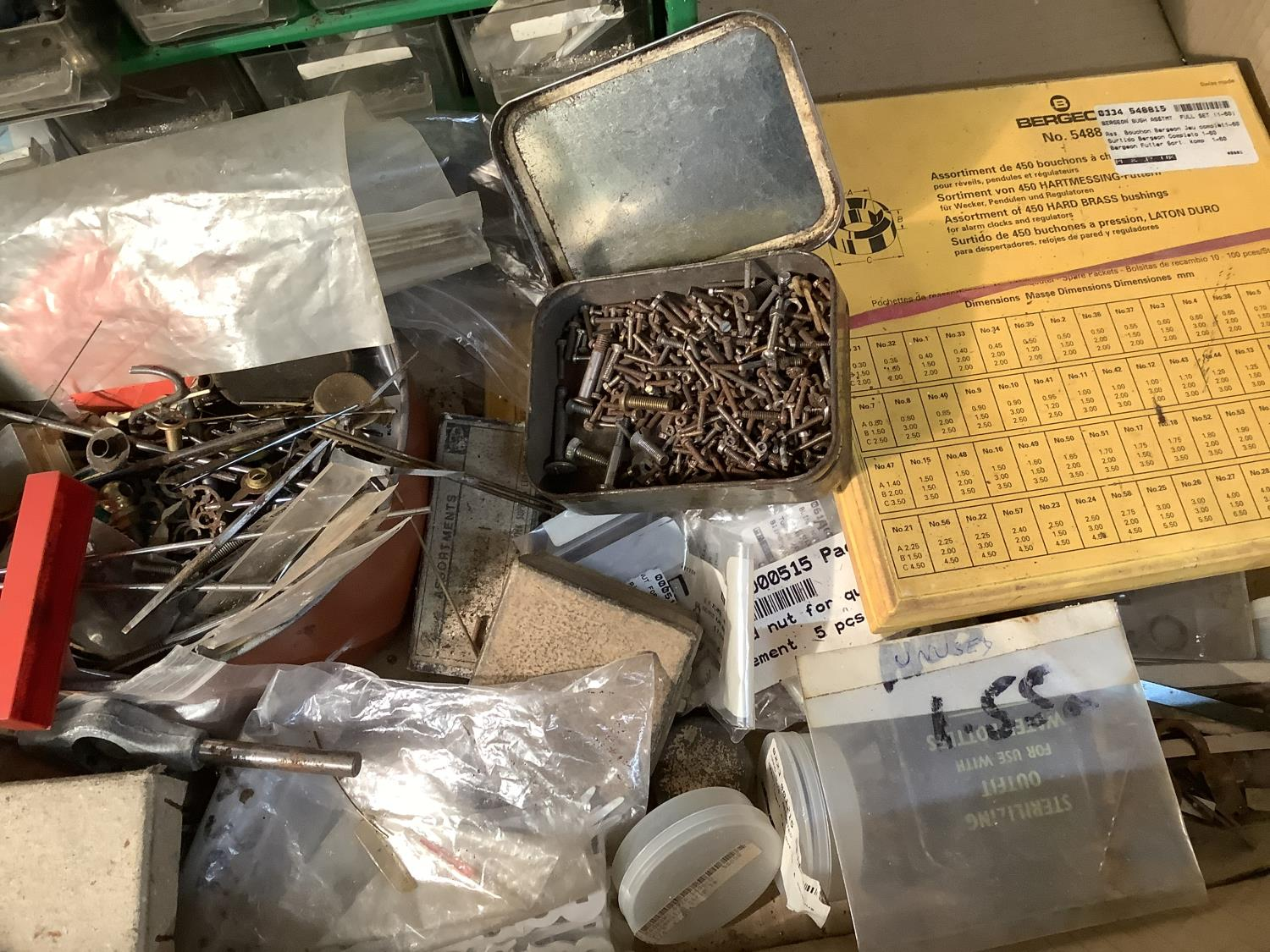 A quantity of horological spares including brass bushes, brass pin, case screws and parts, clock - Image 3 of 5