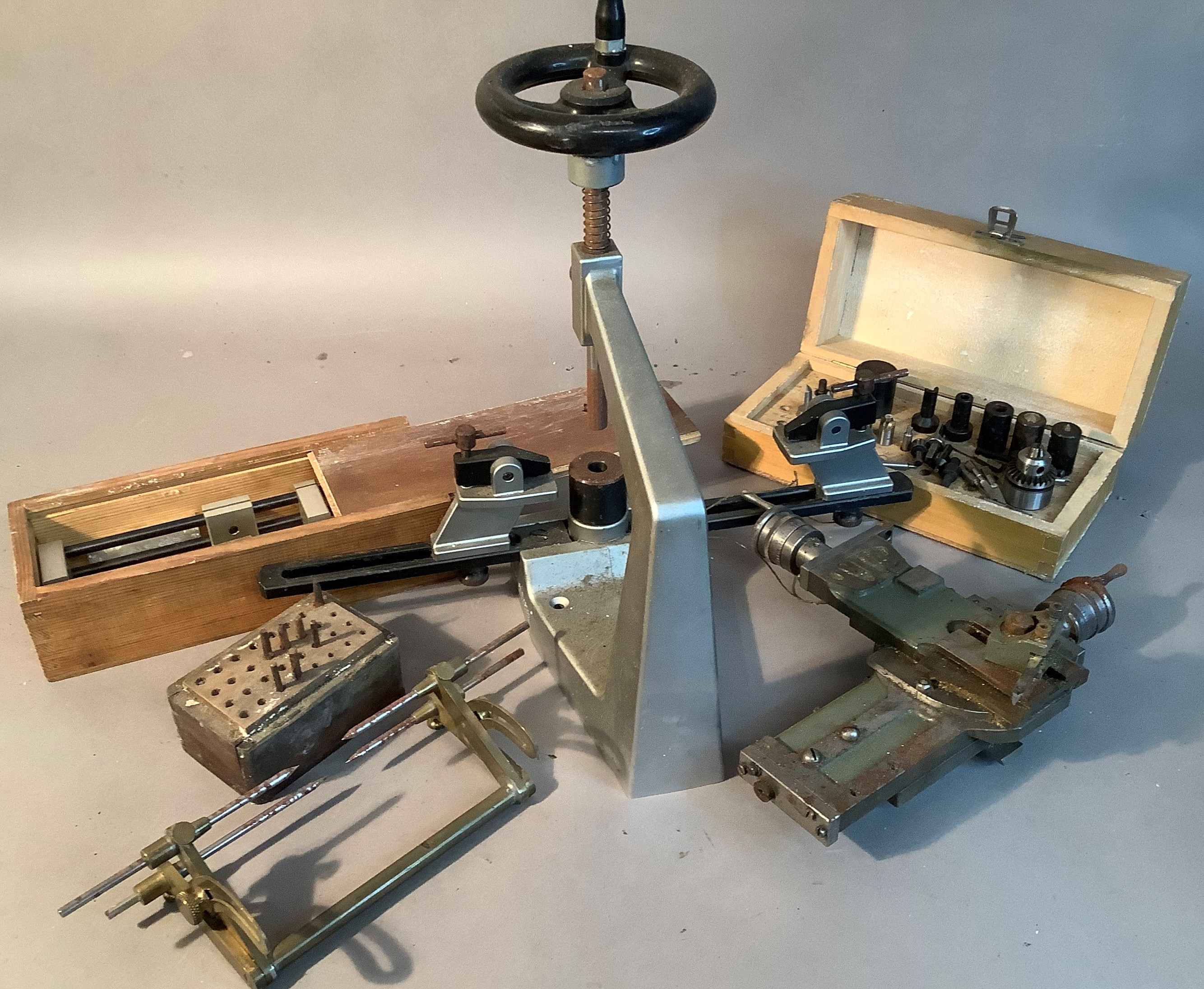 A Bergeon No6200 clock bushing tool with instruction booklet and some associated tools; together