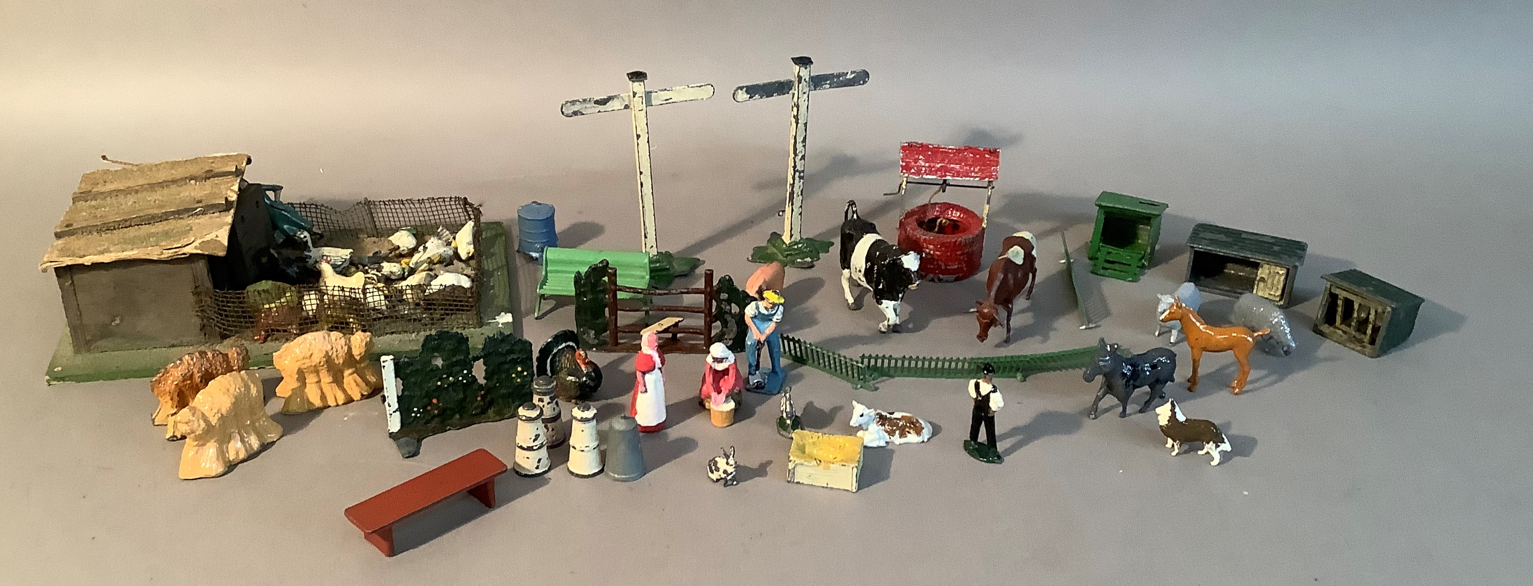 A quantity of Britain's farm yard figures and accessories to include dog kennels, chicken coops,