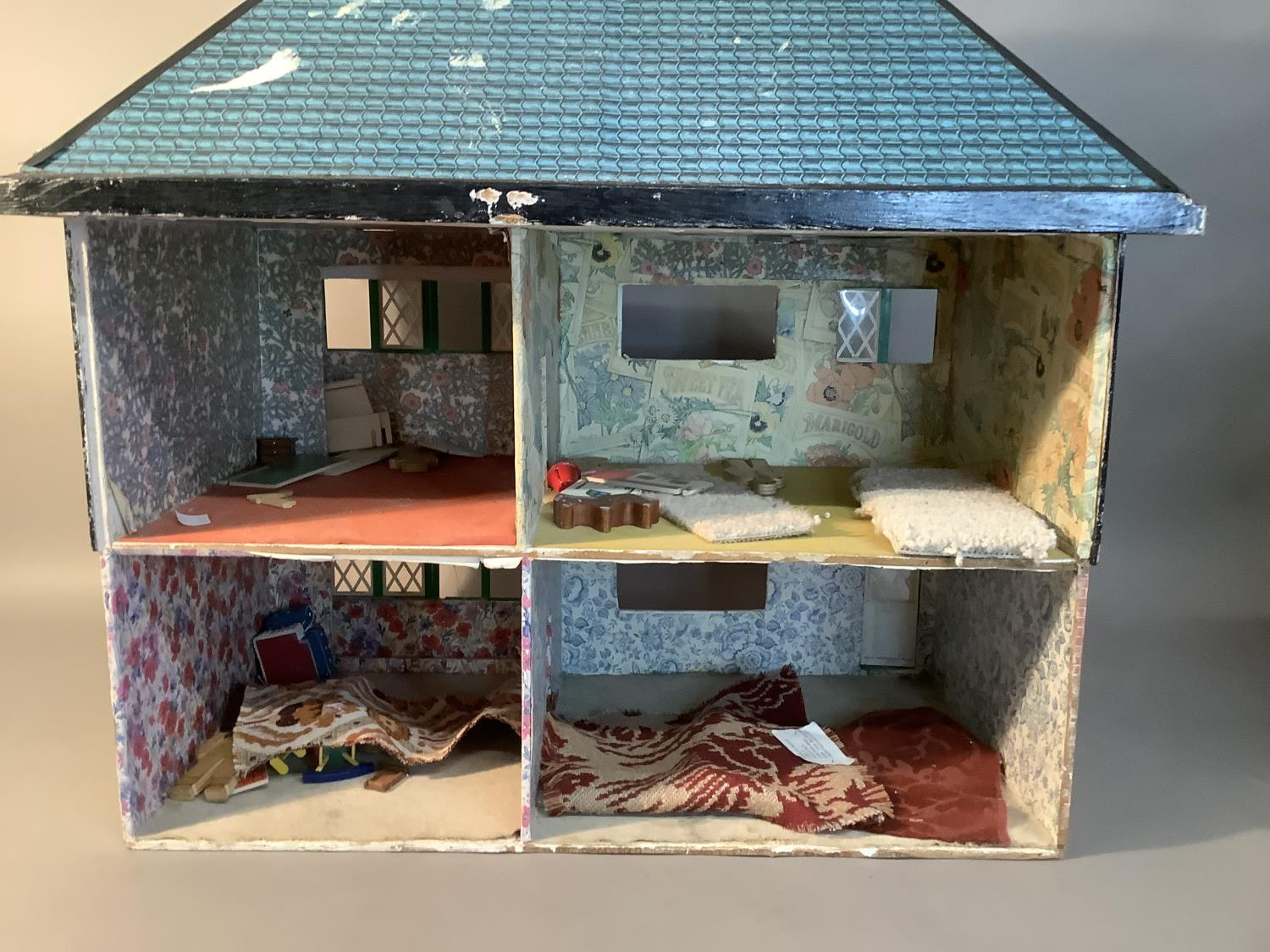 A Tudor style painted wooden dolls house with blue tiled roof, green and crème windows, 65cm wide - Image 2 of 2