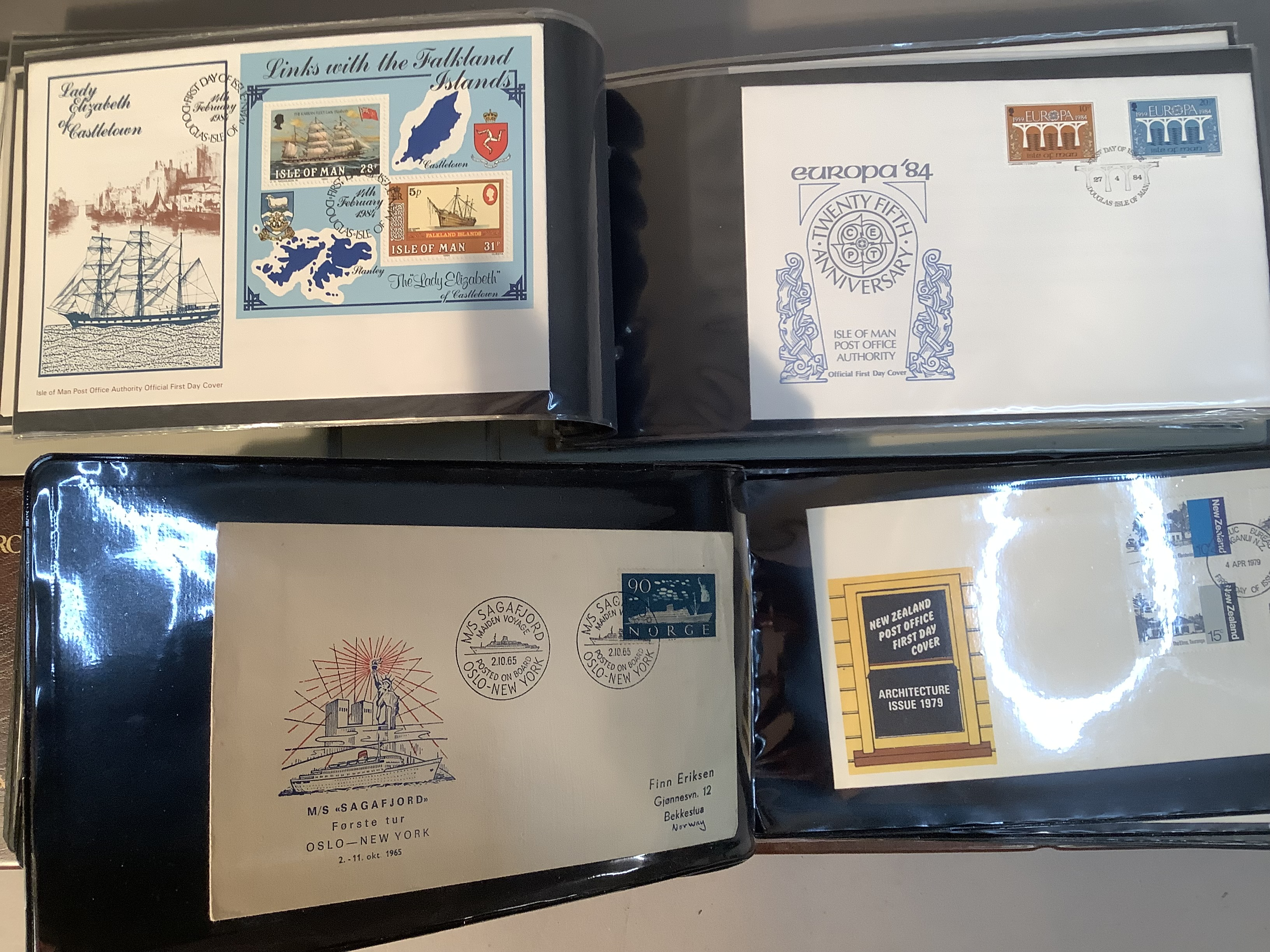 Two ring folders with approximately 100 world FDC's including India, Australia and Isle of Man,