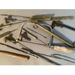 A small selection of horological hand tools including an archimedean drill, brackets, toffee