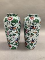A pair of Losol ware vases of tapered cylindrical form, printed and enamelled with scattered