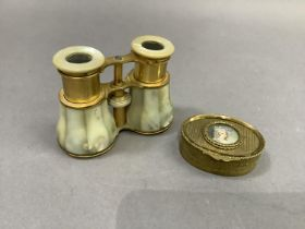 A pair of mother-of-pearl and gilt metal opera glasses together with a gilt metal jewel box of