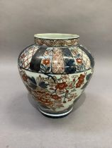 A 19th century baluster vase decorated in Imari pallet with flowers and leafage beneath formal