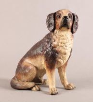 A good hollow terracotta model of a seated dog, realistically modelled and painted in creams and