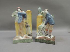 A pair of Rye Pottery golfing figure bookends