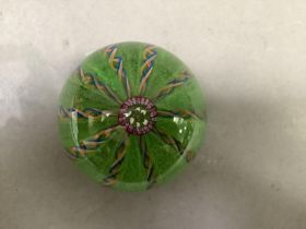 A limited edition glass paperweight, the centre inscribed A.M, dated 1973, with blue, white and