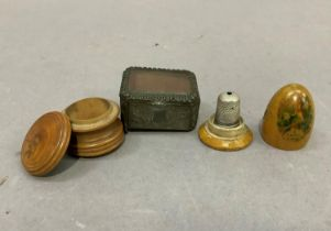 A 19th century turned fruit wood circular box with screw on lid, a treen thimble holder transfer