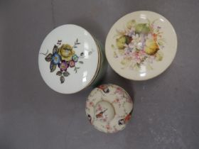 A Royal Worcester dish and cover painted with floral sprays within gilt rim lines, another printed