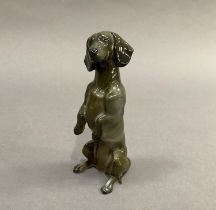 A Rosenthal figure of a Dachshund sitting upright on his hind legs, approximately 12cm