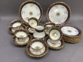An Aynsley china tea service, the white ground, moulded and highlighted in gilt with c-scrolls and