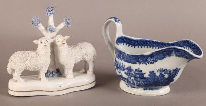 A Leeds Pottery sauce boat, transfer printed in underglaze blue with a willow pattern, 19cm wide,