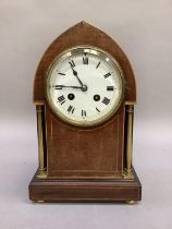 An Edward VII mahogany mantel clock with boxwood stringing, of lancet outline with brass rimmed