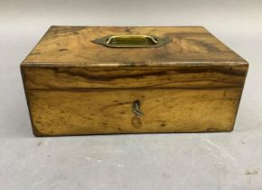 A Victorian figured walnut jewel box having a brass recessed handle to the cover, the interior lined