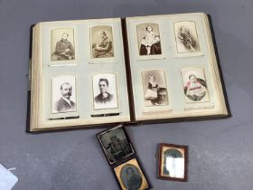 A Victorian calf bound photograph album with quantity of inset black and white photographs