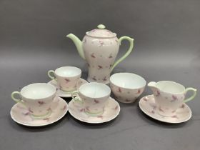 A Shelley Lyric pattern coffee pot, sugar and cream, three cups and four saucers (one cup cracked)