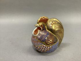 A Royal Crown Derby cockerel paperweight with gold button, 10cm wide, 10cm high