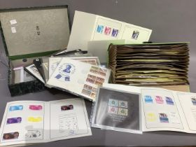 A quantity of stamps to include a box of nine various albums, box file GWFDC, a bag various, tube