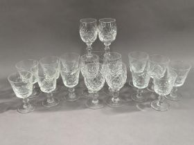 Eleven cut glass wines on knopped stems together with another set of six wines on knopped stems (17)