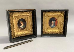 A pair of late 19th century oval portrait miniatures; one of a young girl holding a candle, the