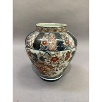 A 19th century baluster vase decorated in Imari palette, with flowers and leafage beneath formal