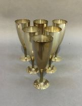 A set of six Mappin & Webb silver plated goblets with textured stems, on circular foot, 17.5cm high