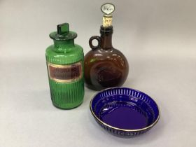 A green glass pharmacy bottle, ribbed and with gilt label for Hydrarg:ammoniat, 19cm high together