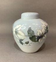 A Royal Copenhagen vase and cover painted with clematis, printed and underglaze blue marks to