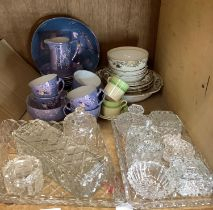 Two cut and pressed glass dressing table sets variously with boxes, trays etc together with a
