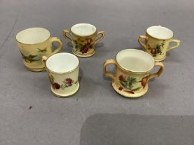 A Royal Worcester miniature mug painted with bluetits on a shaded apricot ground, 4cm high;