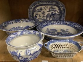 A Masons ironstone chamber pot transfer printed in underglaze blue with birds, flowers and