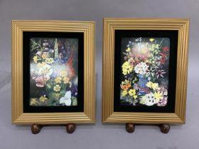 A pair of ceramic Coalport floral decorated plaques