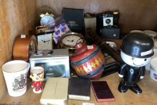 A quantity of mantel clocks, a Metamec quartz wall clock, vintage and later cameras, commemorative