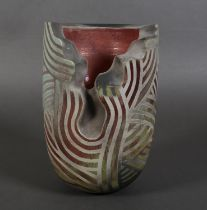 Paul Muchan (b.1948), an earthenware vase, cut away section to the body, matt grey linear designs on