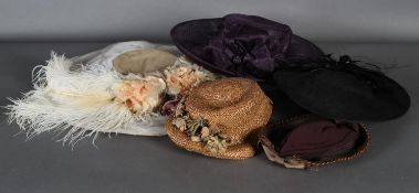 A 1920s straw hat with flowers to brim, two modern occasion hats and a fancy dress hat