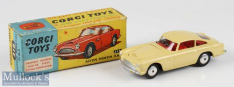 Corgi Toys Diecast 218 Aston Martin DB4 in cream with red interior, boxed, good condition with small