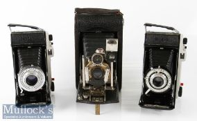 Kodak No3 folding pocket camera with autotimer patent 1908 model G together with Kodak Sterling II