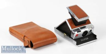 Polaroid SX-70 land camera with original leather grip inserts appears with some signs of wear, signs