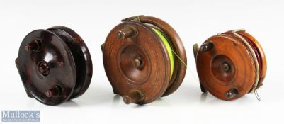 """2x Nottingham wood and brass reels to include a 4 ¼"""" reel with brass strapback, a 3 ½"""" wood and"""