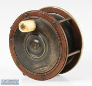 """Carter & Sons London 4 ½"""" ebonite and brass Salmon reel with maker's details to faceplate,"""