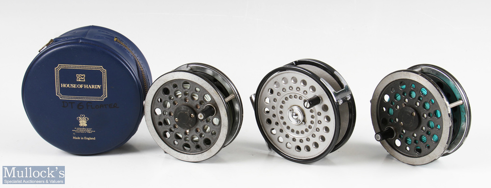 """2x J W Young & Sons 3 ½"""" alloy fly reels both spins well, with line, surface wear, together with"""