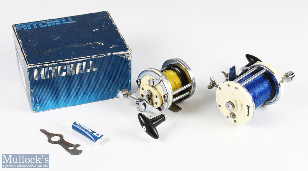 Mitchell 600 multiplier salt water reel with white end plates and chrome construction, with rod