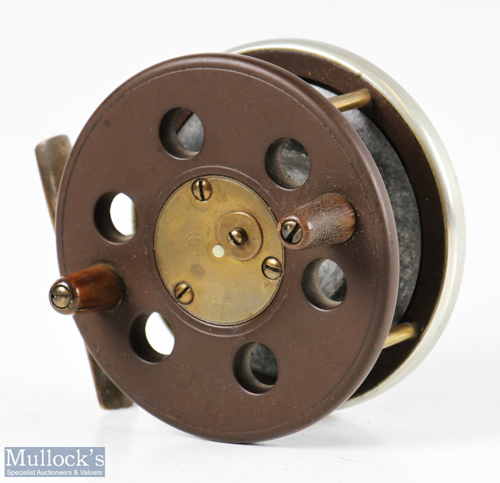 """Slater pattern 3 ½"""" ebonite and brass combination reel with brass star back, nickel silver rim,"""