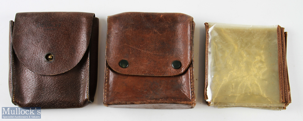 M C Thorburn Edinburgh leather cast wallet together with another unnamed cast wallet with plastic
