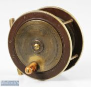 """Prickman of Exeter 4"""" brass and ebonite reel having German silver rims, smooth brass foot, makers"""
