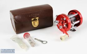 ABU Ambassadeur 6000 multiplier reel stamped 040500, finished in red, counter balance handle, with