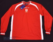 Newtown AFC Home football shirt size M, in red, Macron, long sleeve, with tag, appears unused