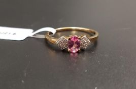 CERTIFIED PINK SPINEL AND WHITE ZIRCON RING the central oval cut pink spinel weighing 0.48cts,
